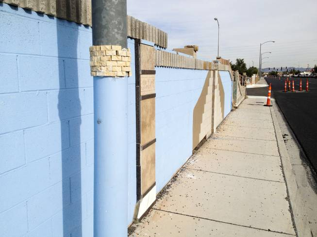 The poperty wall to a Las Vegas home on Red Barn Lane is painted blue tying it back into the homes overall blue decorative theme, Wednesday, Nov. 14, 2012.