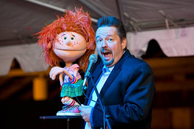 Terry Fator and Emma Taylor perform during the ceremonial opening of the Glittering Lights show at Las Vegas Motor Speedway, Thursday, Nov. 15, 2012.
