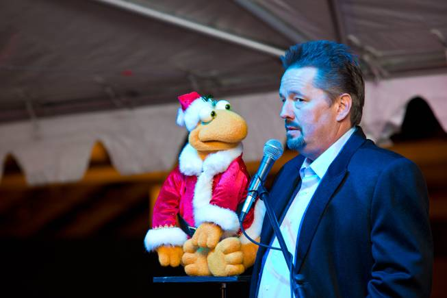 Terry Fator and Winston The Impersonating Turtle perform during the ceremonial opening of the Glittering Lights show at Las Vegas Motor Speedway, Thursday, Nov. 15, 2012.