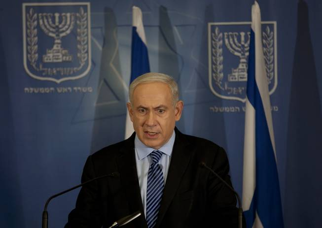 Israel's Prime Minister Benjamin Netanyahu delivers a statement to the media at Hakirya a military base in Tel Aviv, Israel, Wednesday, Nov. 14, 2012. Israel's prime minister says the military is prepared to broaden its operation against Hamas targets in Gaza. Netanyahu says Israel cannot tolerate continued rocket attacks against its citizens.