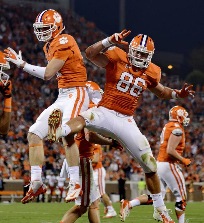Clemson tight end Stanston Seckinger, left, celebrates with Sam Cooper after scoring a touchdown during the second half of an NCAA college football game against Maryland on Saturday, Nov. 10, 2012, at Memorial Stadium in Clemson, S.C. Clemson won 45-10.