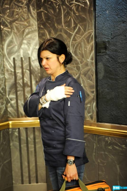 "Carla Pellegrino and her bandaged hand on Bravo's ""Top Chef"" on Wednesday, Nov. 14, 2012."