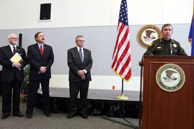 "Sheriff Doug Gillespie, right, speaks during a press conference held by the U.S. Department of Justice Office of Community Oriented Policing Services at the Lloyd George Federal Building in Las Vegas on Thursday, November 15, 2012. The press conference was regarding an eight-month review of Las Vegas Metropolitan Police Department's use of force policies and practices. From left is James ""Chips"" Stewart, a senior fellow of public safety at CNA Analysis & Solutions, Nevada U.S. Attorney Daniel Bogden and Bernard Melekian, the director of the U.S. Department of Justice Office of Community Oriented Policing Services."