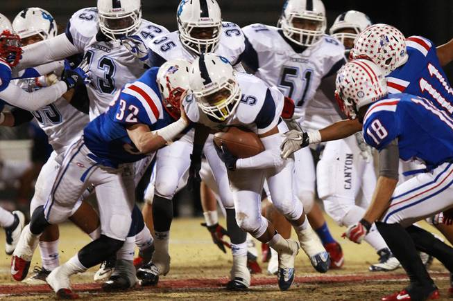 Canyon Springs running back D.J. Pumphrey finds his hole in the Liberty line during their playoff game Friday, Nov. 16, 2012. Liberty won 10-0.