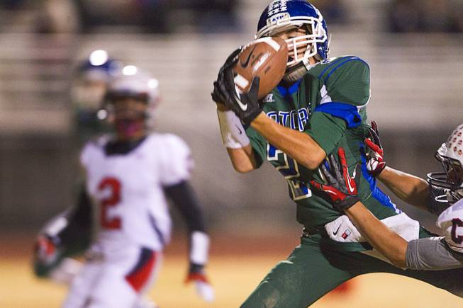 Green Valley's Markus Varner pulls in a pass that he carries in for Green Valley's first touchdown during the Sunrise regional semifinal against Coronado at Green Valley High School in Henderson Friday, November 16 , 2012.