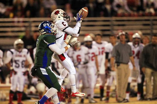 Coronado's Kieran Eissler nearly intercepts a pass intended for Green Valley's Kohorst Quintin during the Sunrise regional semifinal at Green Valley High School in Henderson Friday, November 16 , 2012. Quintin couldn't manage to complete the catch.