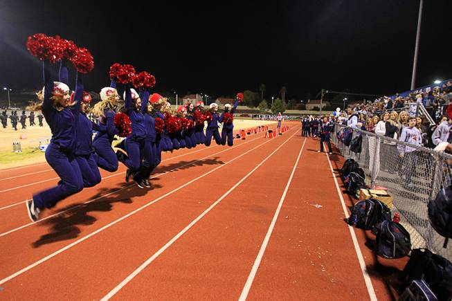 Members of the Cougarettes Dance team jump for a photo at halftime during the Sunrise regional semifinal at Green Valley High School in Henderson Friday, November 16 , 2012.