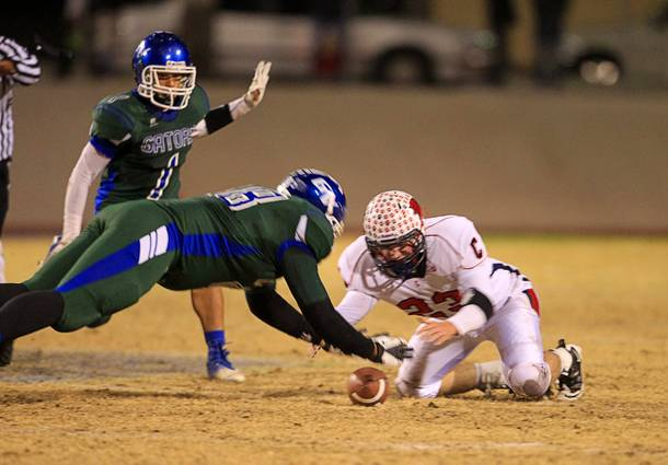 Green Valley's Tyrell Crosby recovers a Green Valley fumble in front of Coronado's Marcus Hunt during the Sunrise regional semifinal at Green Valley High School in Henderson Friday, November 16 , 2012.