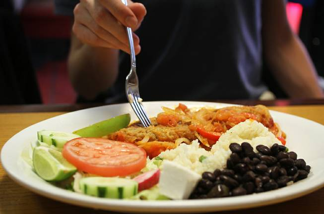 El Santaneco specializes in Guatemalan cuisine, but also serves El Salvadoran and Mexican dishes. Here, a diner prepares to dig into a chile relleno.