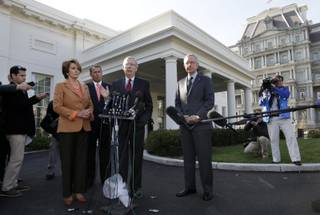 Senate Minority Leader Mitch McConnell of Ky., accompanied by, from left, House Minority Leader Nancy Pelosi of Calif., House Speaker John Boehner of Ohio, and Senate Majority Leader Harry Reid of Nev., speaks reporters outside the White House in Washington, Friday, Nov. 16, 2012, after meeting with President Barack Obama to discuss the economy and the deficit.