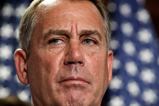 In this July 24, 2012, photo, House Speaker John Boehner, R-Ohio, talks to reporters following a closed-door political strategy session at the Capitol in Washington.