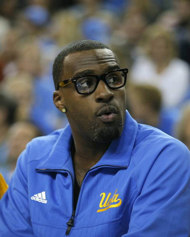 UCLA's Shabazz Muhammad looks on while sitting on the bench during the first half of an NCAA college basketball game against the Indiana State in Los Angeles, Nov. 9, 2012.