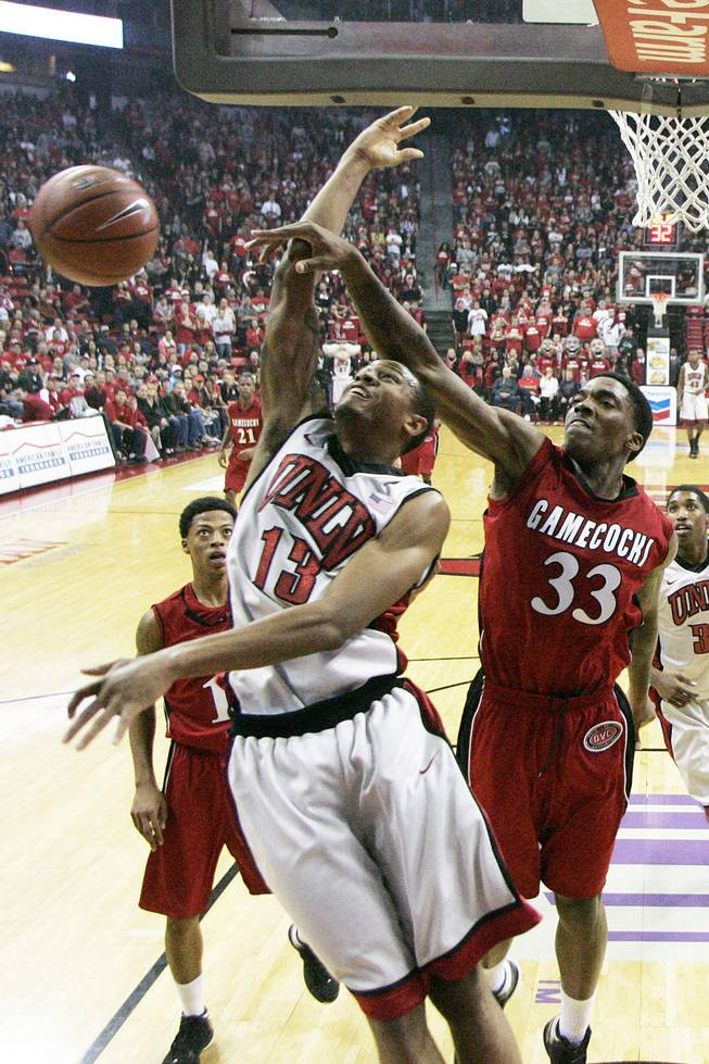 UNLV guard Bryce Dejean-Jones gets fouled by Jacksonville State forward Nick Cook during their game Saturday, Nov. 17, 2012 at the Thomas & Mack. UNLV won 77-58.