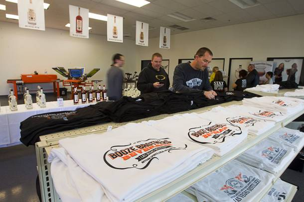 Rus Apfel looks over T-shirts at the Half Full Artisan Shop during the Historic First Edition Day at the Las Vegas Distillery in Henderson Saturday, November 17, 2012. The event marks the first bottling of several new spirits and the grand opening of the Booze Brothers Beverage distribution company and the Half Full Artisan Shop at the Distillery, a retail store. The spirits include Nevada vodka, whiskey, gin, rum and moonshine.
