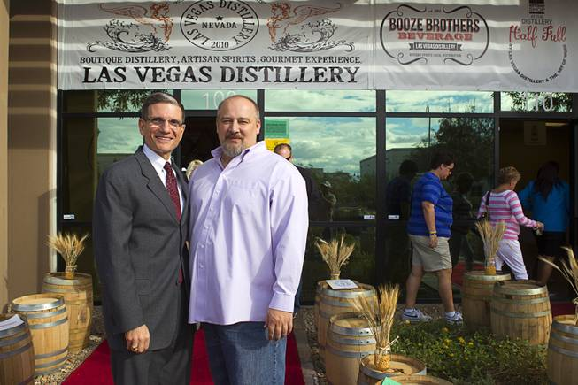 Congressman Joe Heck (R-NV), left, poses with Las Vegas Distillery founder George Racz during the Historic First Edition Day at the Las Vegas Distillery in Henderson Saturday, November 17, 2012. The event marks the first bottling of several new spirits and the grand opening of the Booze Brothers Beverages distribution company and the Half Full Artisan Shop at the Distillery, a retail store. The spirits include Nevada vodka, whiskey, gin, rum and moonshine.