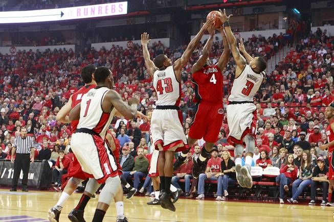 UNLV's Mike Moser and Anthony Marshall defend Jacksonville State forward Tarvin Gaines during their game Saturday, Nov. 17, 2012 at the Thomas & Mack.