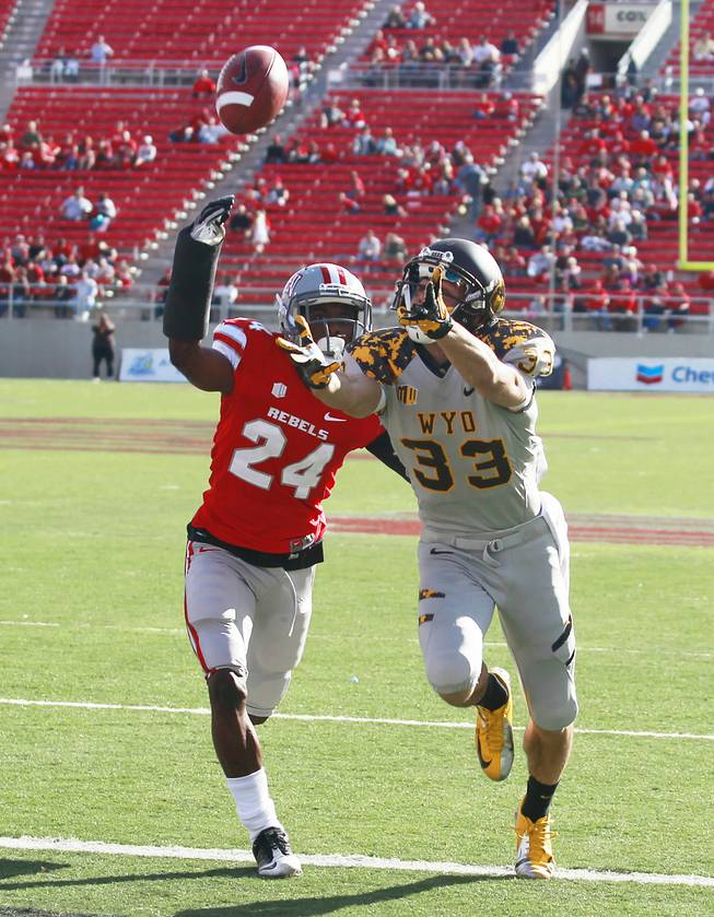 UNLV defensive back Fred Wilson defends Wyoming wide receiver Dominic Rufran during the first half of their game Saturday, Nov. 17, 2012 at Sam Boyd Stadium.
