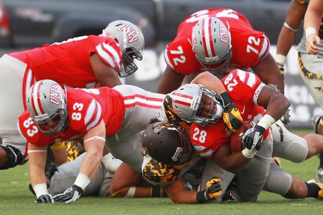 UNLV running back Bradley Randle is brought down by a Wyoming player during their game Saturday, Nov. 17, 2012 at Sam Boyd Stadium. Wyoming won 28-23.