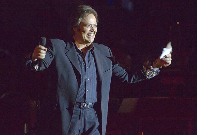 Jimmy Osmond, president of Osmond Entertainment, gets the audience ready for a performance by entertainer Jerry Lewis at the Orleans Showroom Sunday, November 18, 2012.