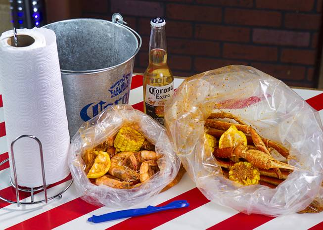 Bags of shrimp and snow crab at California Crab, a restaurant at 9560 S. Eastern Ave. Sunday, November 18, 2012. Shrimp, left, served with corn, lemon and potatoes, is $9.99 per pound. Snow crabs legs, right, are market priced. Bananas in Pajamas ($6.99) is a bowl of Magnolia ube, a Filipino purple yam ice cream, surrounded by small sticks of hot fried bananas.