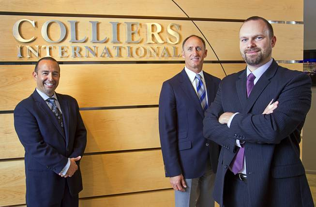 Gabriel Telles, left, Michael Mixer, center and Joshua Smith pose at Colliers International Monday, November 19, 2012. The trio are members of a Colliers gaming group focused on helping investors buy and sell casinos and gaming property.
