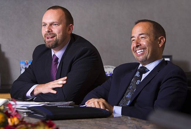Joshua Smith, left, and Gabriel Telles react during an interview at the Colliers International commercial real estate brokerage Monday, November 19, 2012. Smith and Telles are part of a Colliers gaming group focused on helping investors buy and sell casinos and gaming property.