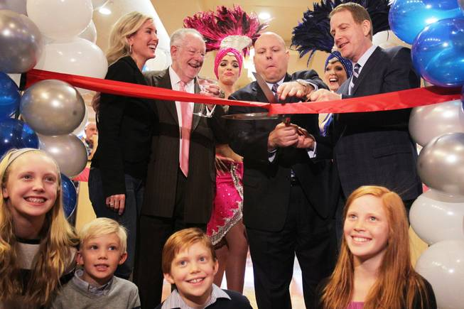 The ribbon cutting ceremony is performed by Lincoln Spoor, from top right, CEO of Feel Good Brands, Jason Shkorupa, vice president of food and beverage for Luxor and Excalibur, former Mayor Oscar Goodman, and Spoor's wife Sarah Spoor during the grand opening of Castle Walk Food Court at the Excalibur in Las Vegas on Tuesday, November 20, 2012. Spoor's children Blakely, from left, 11, Campbell, 6, Walker, 8, and Savannah, 10, are seated in front.