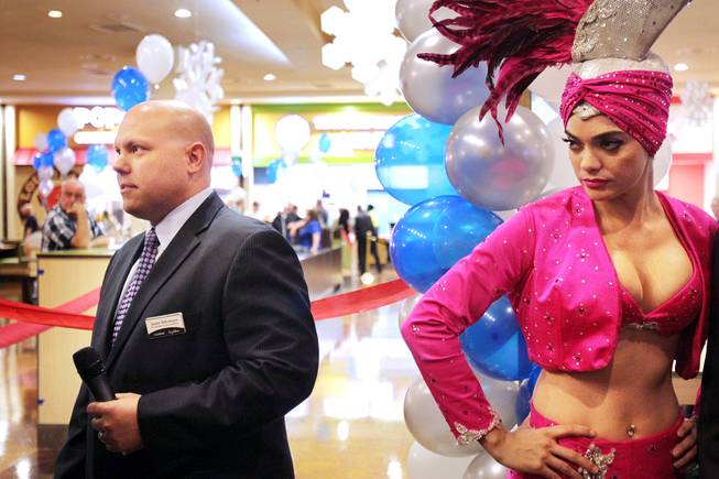 Jason Shkorupa, left, vice president of food and beverage for Luxor and Excalibur, and Porsha Revesz, right, wait to begin the ribbon cutting ceremony during the grand opening of Castle Walk Food Court at the Excalibur in Las Vegas on Tuesday, November 20, 2012.