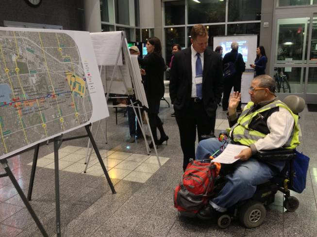 Maryland Parkway Alternatives Analysis Study project manager David Swallow, left, discusses the Maryland Parkway transit corridor with Las Vegas resident Dean Kelley,right, at a public workshop meeting at the Bonneville Transit Center on Nov. 14. PHOTO BY RICHARD N. VELOTTA