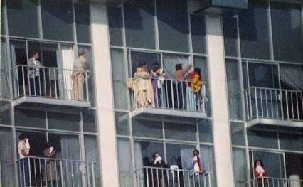 People are seen waiting on their balconies for rescue crews during the MGM Grand Nov. 21, 1980, fire.