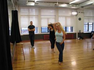 "Coco works with Jerry Mitchell and Paula Caselton during ""Peepshow"" rehearsals in New York."