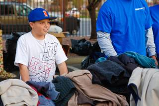 9 year-old Blaze Trumble hands out jackets to the homeless at the Las Vegas Rescue Mission the day before Thanksgiving, Wednesday, Nov. 21, 2012. Blaze started a blanket and jacket donation drive when he was 6 year-old and has continued the charitable tradition ever since.