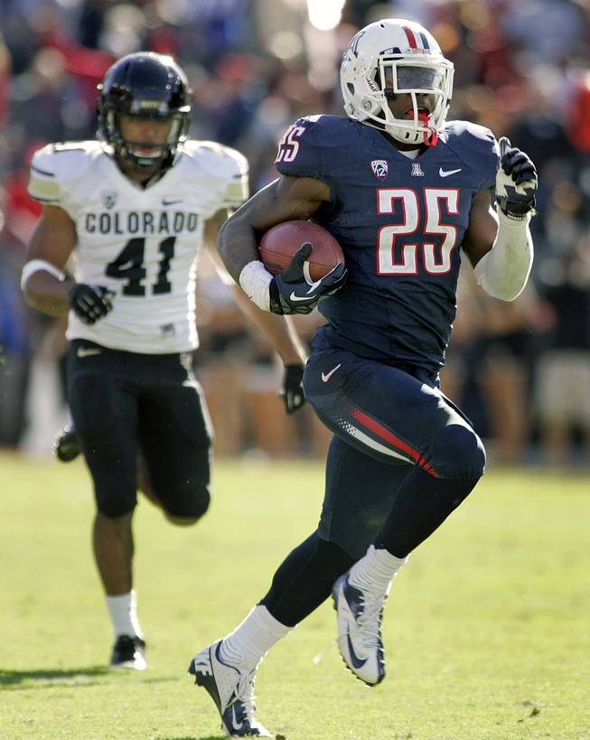 Arizona's Ka'Deem Carey (25) runs for a long gain against Colorado during the second half of an NCAA college football game at Arizona Stadium in Tucson, Ariz., Saturday, Nov. 10, 2012. Carey run for five touchdowns and 366 yards. Arizona won 56 - 31.