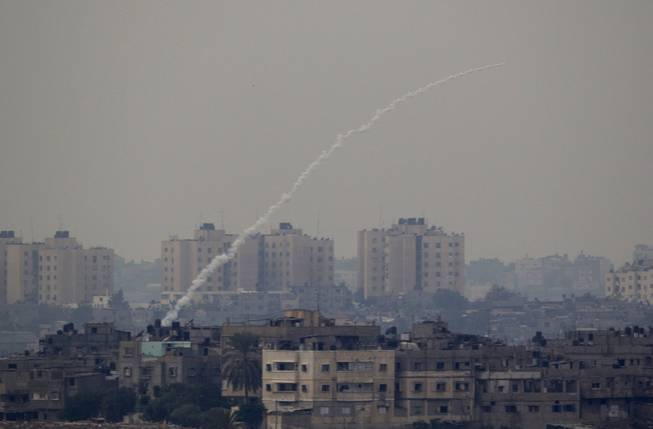 A rocket fired by Palestinian militants from the Gaza Strip towards Israel is about to explode inside the Gaza Strip as seen from the border between Gaza strip and Southern Israel, Wednesday, Nov. 21, 2012, before a truce in the fighting was announced.
