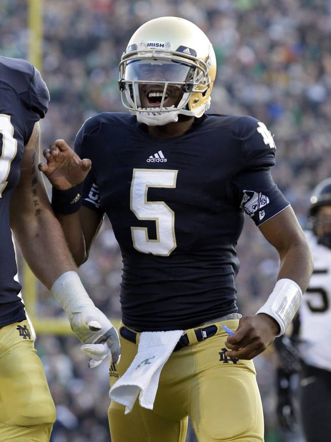 Notre Dame quarterback Everett Golson reacts after throwing for a touchdown against Wake Forest during the first half of an NCAA college football game in South Bend, Ind., Saturday, Nov. 17, 2012.