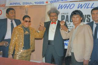 Promoter Don King, holds up the fists of Hector ?Macho? Camacho former World Super Featherwight Champion (left) and Roque Montoya (right) Mexican lightweight champ on March 7, 1985. Both will fight a 12 rounder for North American lightweight crown which is vacant. Fight will in Buffalo on April 29th, with other bouts.