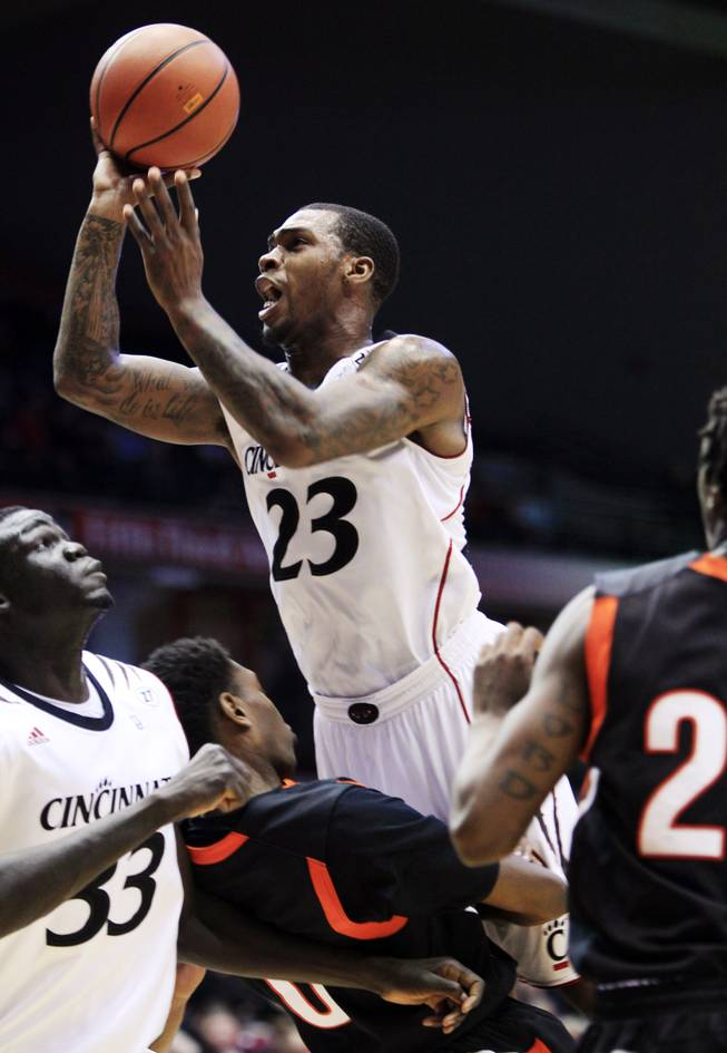 Cincinnati guard Sean Kilpatrick (23) drives against Campbell on Nov. 20, 2012, in Cincinnati. Kilpatrick is averaging 19.5 points and 6.8 rebounds per game for the 22nd-ranked Bearcats.
