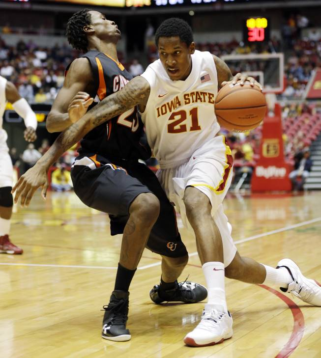 Iowa State guard Will Clyburn, right, tries to drive to the basket against Campbell on Nov. 18, 2012, in Ames, Iowa. Clyburn, who played one season in Utah before transferring to the Cyclones, leads the team in points and rebounds.