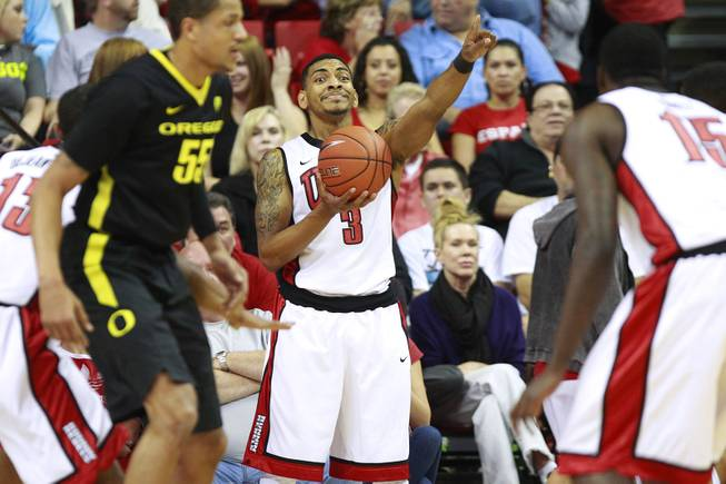 UNLV guard Anthony Marshall directs his teammates before inbounding the ball during their game against Oregon Friday, Nov. 23, 2012 in the Global Sports Classic. Oregon upset the 18th-ranked Rebels 83-79.