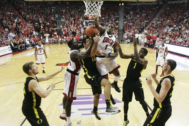 UNLV forward Anthony Bennett, left, and Quintrell Thomas defend Oregon forward Arsalan Kazemi during their game Friday, Nov. 23, 2012 in the Global Sports Classic. Oregon upset the 18th-ranked Rebels 83-79.