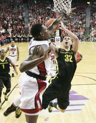 UNLV forward Quintrell Thomas defends Oregon forward Ben Carter during their game Friday, Nov. 23, 2012 in the Global Sports Classic. Oregon upset the 18th-ranked Rebels 83-79.