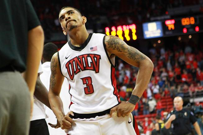UNLV guard Anthony Marshall walks off the court after the Runnin' Rebels were upset by Oregon 83-79 Friday, Nov. 23, 2012 in the Global Sports Classic.