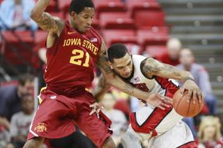 Iowa State guard Will Clyburn defends UNLV guard Anthony Marshall during their game Saturday, Nov. 24, 2012 in the Global Sports Classic at the Thomas & Mack Center.