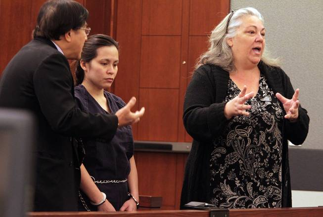 Sounilak Ouchlaeun, center, appears in court with interpreter Thirawat Apichonrattanakorn, left, and public defender Christy Craig, right, at the Regional Justice Center in Las Vegas on Tuesday, November 27, 2012. Ouchlaeun is charged with murder with a deadly weapon for running over her boyfriend with a car.