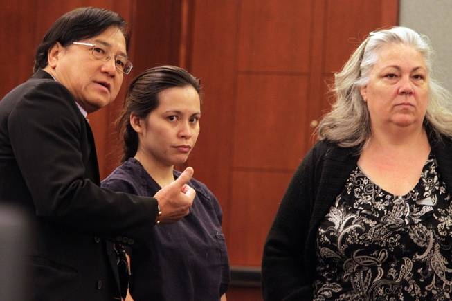Sounilak Ouchlaeun, center, appears in court with interpreter Thirawat Apichonrattanakorn, left, and public defender Christy Craig, right, at the Regional Justice Center in Las Vegas on Tuesday, November 27, 2012.