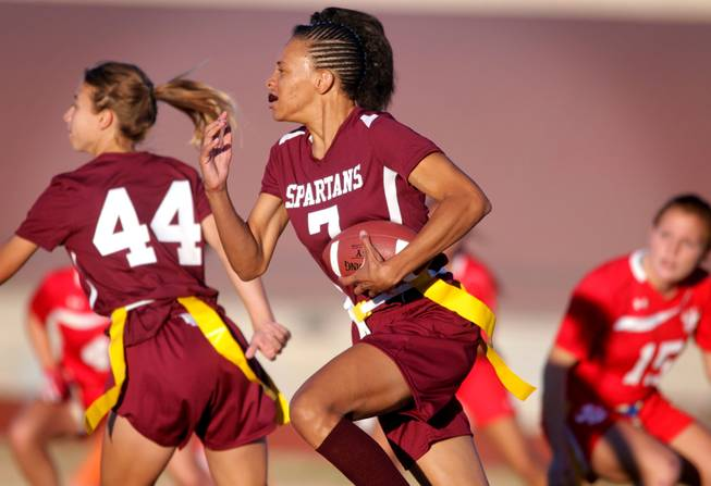 Tiffany Hargrove of Cimarron-Memorial runs with the ball during their girls flag football game against Arbor View at Cimarron-Memorial High School on Monday, November 26, 2012.