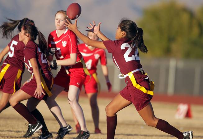 Briana Callejo of Cimarron-Memorial catches the ball during their girls flag football game against Arbor View at Cimarron-Memorial High School on Monday, November 26, 2012.