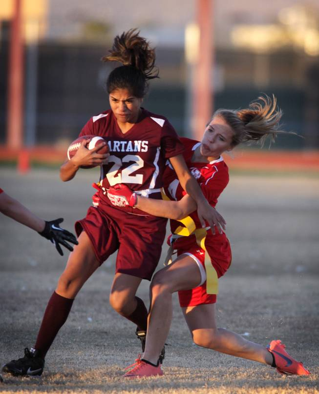 Francesca D'Arienzo of Arbor View goes for the flag of Briana Callejo of Cimarron-Memorial during their girls flag football game at Cimarron-Memorial High School on Monday, November 26, 2012.