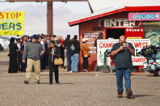 As the jackpot in the multi-state Powerball lottery passes $500 million, buyers leave the Arizona Last Stop in White Hills, Ariz. Tuesday, Nov. 27, 2012.
