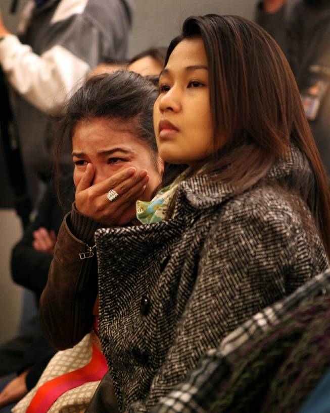 A supporter of Sounilak Ouchlaeun, who declined to be named, cries as she watches Ouchlaeun appear in court at the Regional Justice Center in Las Vegas on Tuesday, November 27, 2012. Ouchlaeun is charged with murder with a deadly weapon for running over her boyfriend with a car.